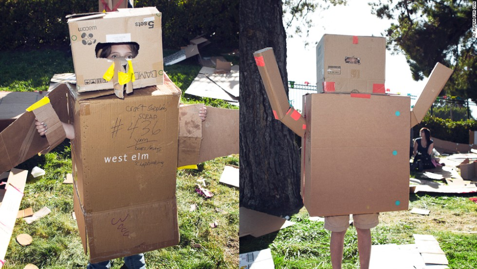 Kids make forts and costumes in the Cardboard Challenge area, a stretch of grass covered with cardboard, tape and other tools. McCawley Yarbrough, left, is a bird and Gabriel Wilson is a robot.