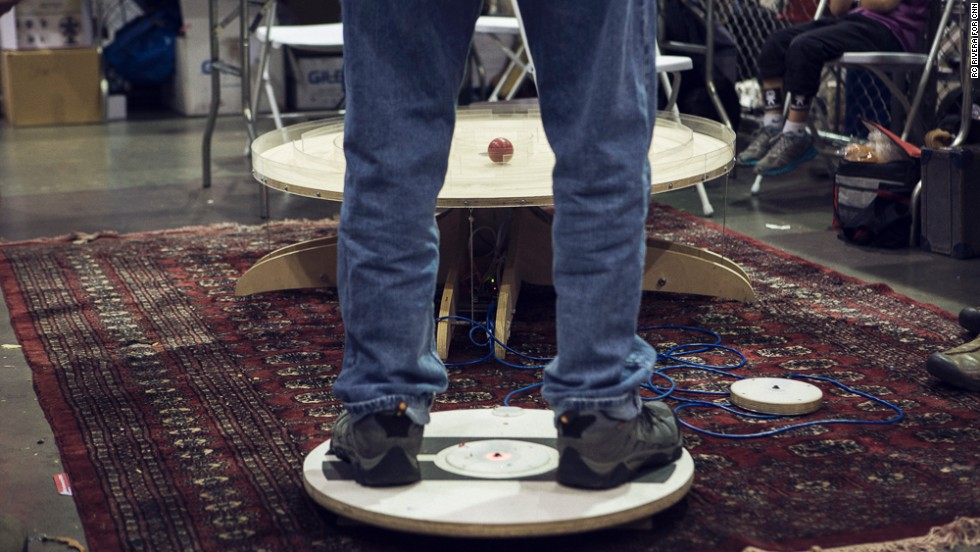 "A man guides a ball through a maze with his body weight on an Arduino-powered board as part of the <a href=""http://www.instructables.com/id/Big-Ball-Maze-Game/"" target=""_blank"">Big Ball Maze Game</a>."