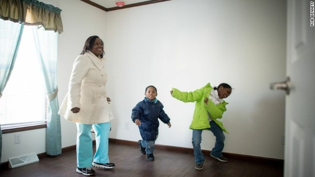 Affordable Housing Alliance beneficiaries Kaneisha Wilson and her two children set foot in their new home for the first time. The displaced family's Beachwood, New Jersey, property suffered extensive damage during Hurricane Sandy.