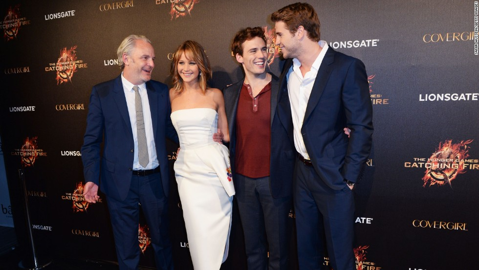 "Director Francis Lawrence and stars Jennifer Lawrence, Sam Claflin and Liam Hemsworth attend the Cannes ""Hunger Games: Catching Fire"" party on May 18."