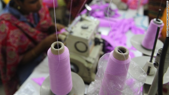 (File photo) A Bangladeshi woman works in a garments factory in Dhaka, Bangladesh.