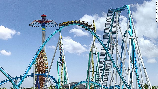 The record-breaking GateKeeper arches through the keyhole of two new towers at Cedar Point's admission gate.