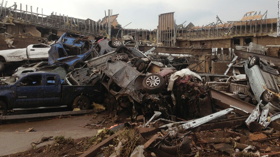 A deadly tornado destroys cars and demolishes structures in the town of Moore, near Oklahoma City, on Monday, May 20.
