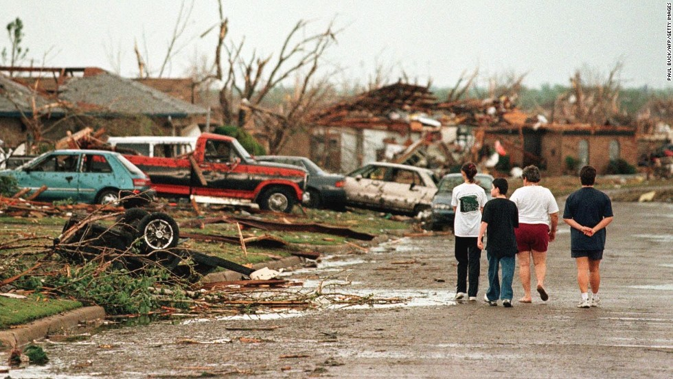 Residents survey the damage in Oklahoma City on May 4, 1999, following a series of deadly tornadoes that ravaged the state.