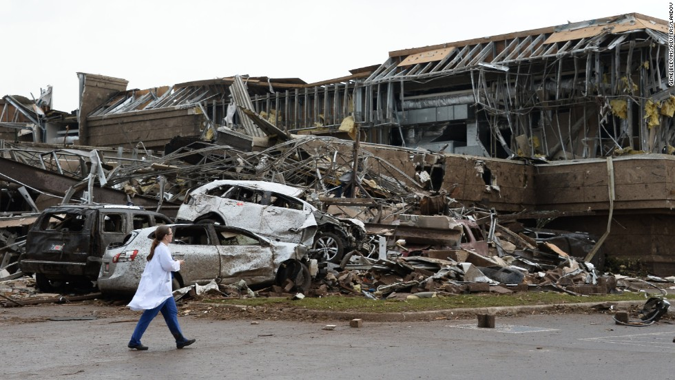 A nurse walks by the destruction at a Moore hospital on May 20.