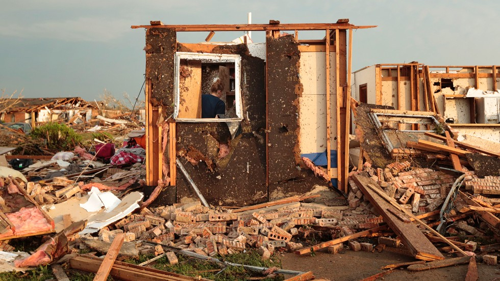 Dana Ulepich searches inside a room left standing at the back of her destroyed house in Moore on May 20.