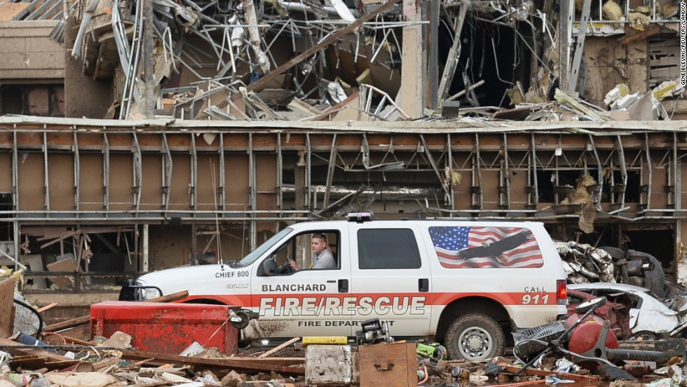 A fire official drives through the rubble of Moore Medical Center on May 20.