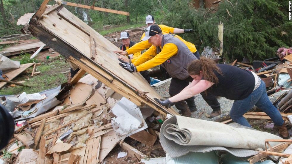 Rescuers search through rubble in Shawnee, Oklahoma, on Monday, May 20. A tornado outbreak hit in the Midwest and Plains on Sunday and Monday, the deadliest hitting Moore, Oklahoma, on Monday.