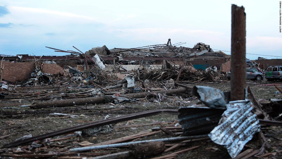 Piles of debris lie around the north side of Plaza Towers Elementary School in Moore on May 21.