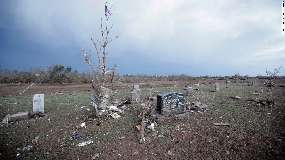 Debris lies among headstones in the Moore Cemetery on May 21.