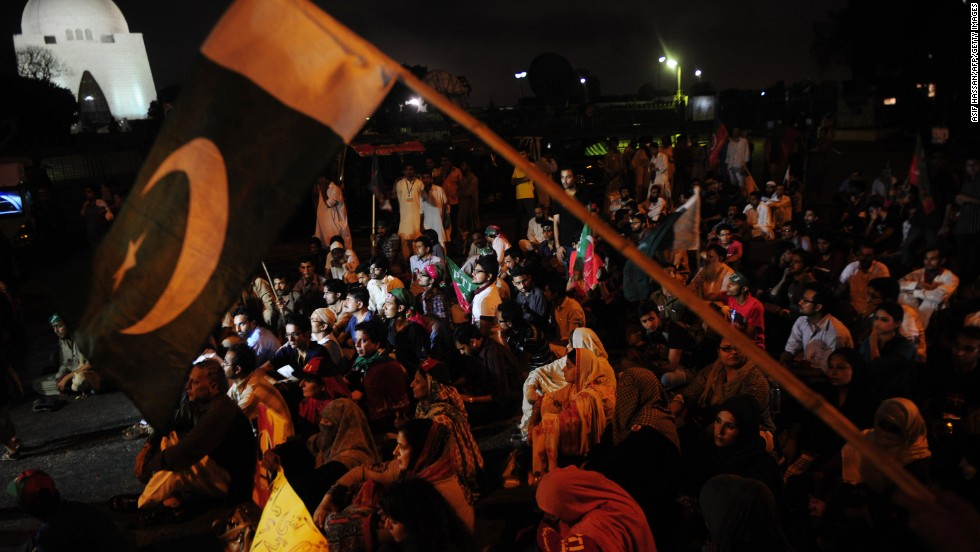 Pakistani supporters of Imran Khan take part in a protest on Monday, May 20, against the killing of Zohra Hussain in Karachi. Hussain, a politician who had alleged vote-rigging in the May 11 elections, was shot dead on Saturday, May 18. There was a re-poll on Sunday, May 19, after accusations of vote-rigging.