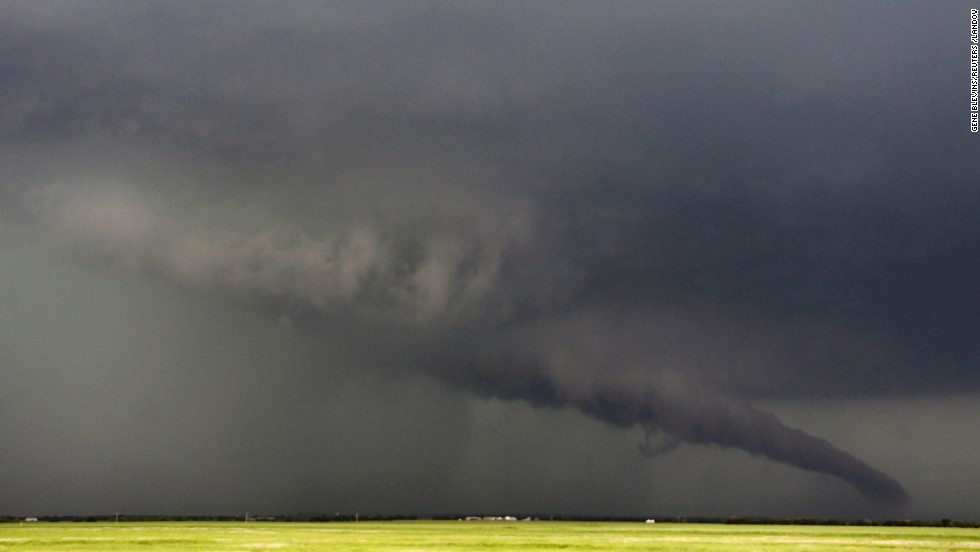 "A funnel cloud stretches toward the ground near South Haven, Kansas, on May 19. As many as<a href=""http://www.cnn.com/2013/05/20/us/gallery/midwest-weather/index.html"" target=""_blank""> 28 tornadoes were reported in Oklahoma, Kansas, Illinois and Iowa</a> on Sunday and Monday, according to the National Weather Service, with Oklahoma and Kansas the hardest-hit,<a href=""http://www.cnn.com/2013/05/20/us/gallery/moore-oklahoma-tornado/index.html?hpt=hp_t1"" target=""_blank""> including a EF4 storm that devastated Moore, Oklahoma</a>."
