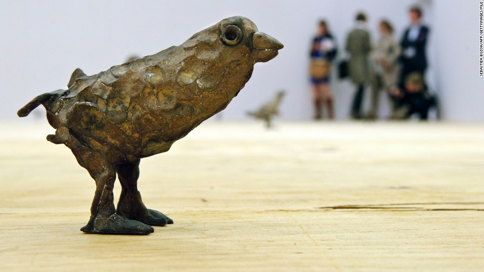 "A work by Ugo Rondina called ""Primitive"" stands on the floor during a preview day in June 2012 for <a href=""https://www.artbasel.com/"" target=""_blank"">Art Basel</a>. The annual exhibition features 20th and 21st century art."