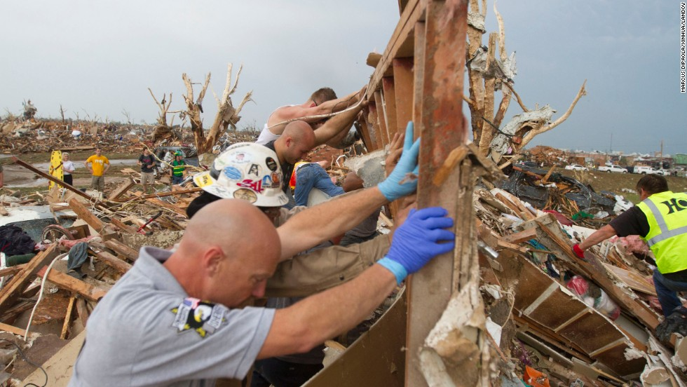 Rescuers dig out a house in Moore on May 21.