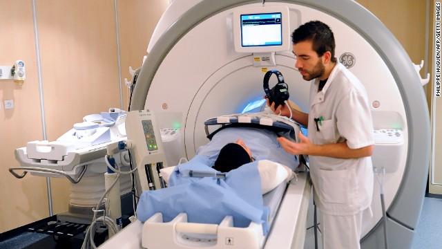 A patient prepares to undergo a MRI (Magnetic resonance imaging, Imagerie par resonance magnetique- IRM in French), on February 6, 2013, at the Oscar Lambret Center in Lille, northern France, a regional medical unit specialised in cancer's treatment.