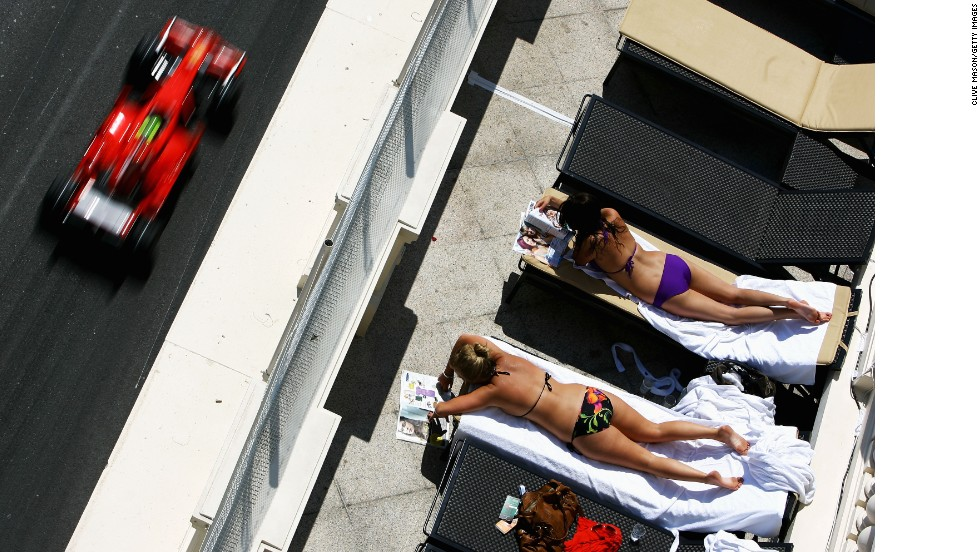 But for some sun-seekers in Monaco, the cars are a distraction...
