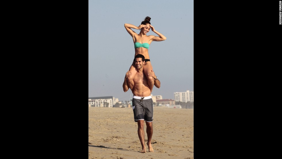 """Dallas"" actor Jesse Metcalfe gave his fiancee, Cara Santana, a lift at the beach in Santa Monica, California, in April 2013."