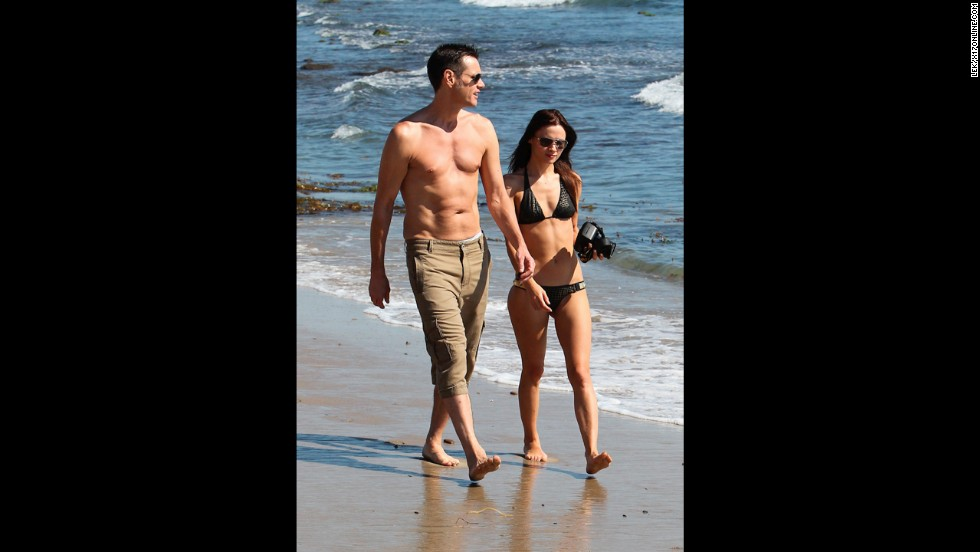 Actor Jim Carrey walked the beach in Malibu with an unidentified woman in September 2012.