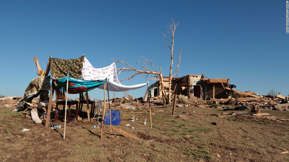 A makeshift shelter stands next to a home destroyed by the tornado on May 22.