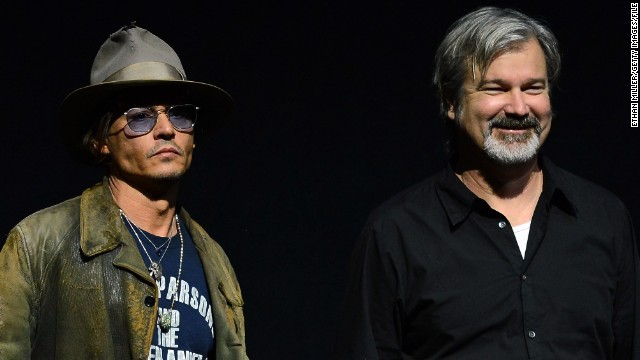 "Director Gore Verbinski, right, with ""The Lone Ranger"" star Johnny Depp at CinemaCon on April 17, 2013."