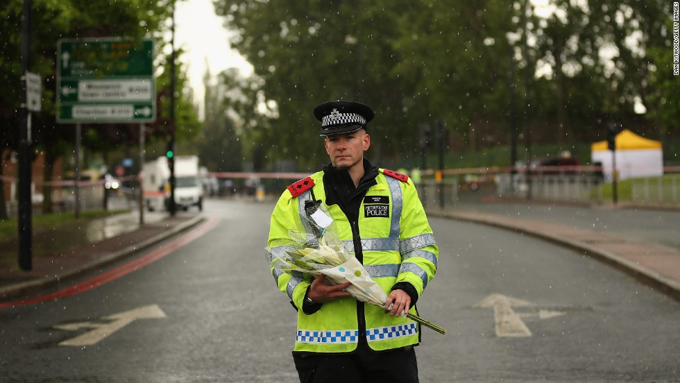 "MAY 24 - LONDON, ENGLAND: On May 23, 2013, a police officer stands in a hail storm close to a crime scene where a <a href=""http://cnn.com/2013/05/23/world/europe/london-attack/index.html?hpt=hp_t1"">soldier from Wellington Barracks was killed in Woolwich</a> on May 22. British Prime Minister David Cameron said the ""appalling"" attack appeared to be terrorism related. He added that  ""nothing in Islam ... justifies this truly dreadful act."""
