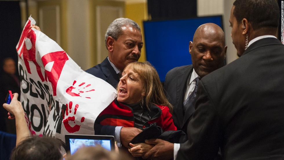 Benjamin is escorted out of the National Rifle Association press conference in Washington held December 21, 2012, one week after the Newtown Elementary School shooting.