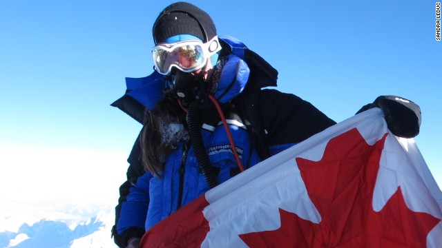 Sandra LeDuc on the summit, holding the Canadian flag.