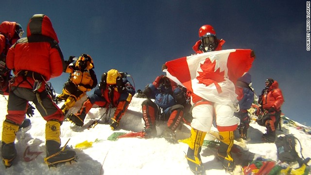 Shriya on the Everest summit, holding the Canadian flag.