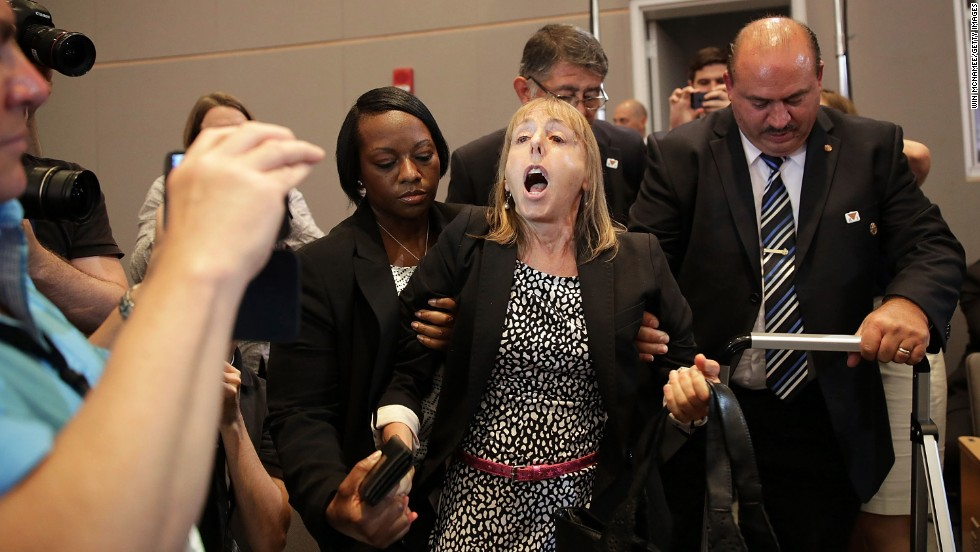Medea Benjamin, an activist and co-founder of the organization Code Pink, shouts at President Barack Obama while he speaks at the National Defense University on Thursday, May 23, in Washington. Benjamin has voiced her opinion at press conferences, hearings and other events for years on matters including drones, Guantanamo and gun control.