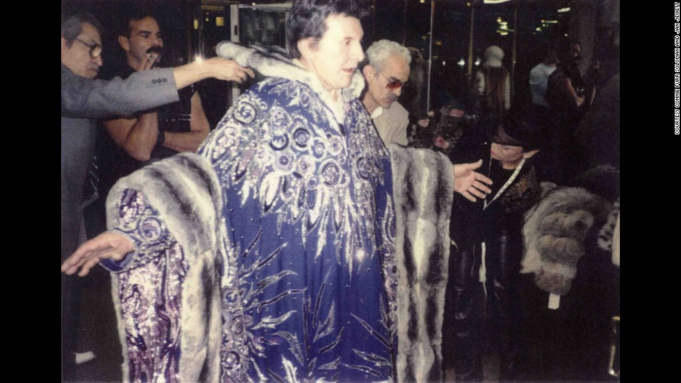 "Liberace's extravagant style is as famous as his music, and his looks will be on full display in Stephen Soderbergh's ""Behind the Candelabra"" when the film premieres on HBO May 26.<a href=""http://marquee.blogs.cnn.com/2013/04/08/trailer-park-behind-the-candelabra/?iref=allsearch"" target=""_blank""> A sneak peek has shown</a> star Michael Douglas as Liberace in an elaborate fur and Matt Damon as his lover Scott Thorson in the snazziest chauffeur suit possible. But Liberace's eye-catching costumes, like this purple and silver cape with rare empress Chincilla fur, are also described in detail <a href=""http://www.amazon.com/Liberace-Extravaganza-Connie-Furr-Soloman/dp/0062202553"" target=""_blank"">in the new book, ""Liberace Extravaganza!"" </a>Here is a selection of some of its images:"