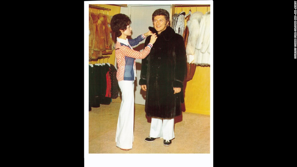 Liberace attends a fitting with Anna Nateece at her salon.