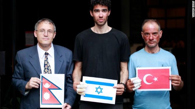 Nadav Ben Yehuda (center) and Aydin Irmak (rightt) with Israeli ambassador to Nepal, Hanan Goder-Goldberger -- all holding their respective flags.