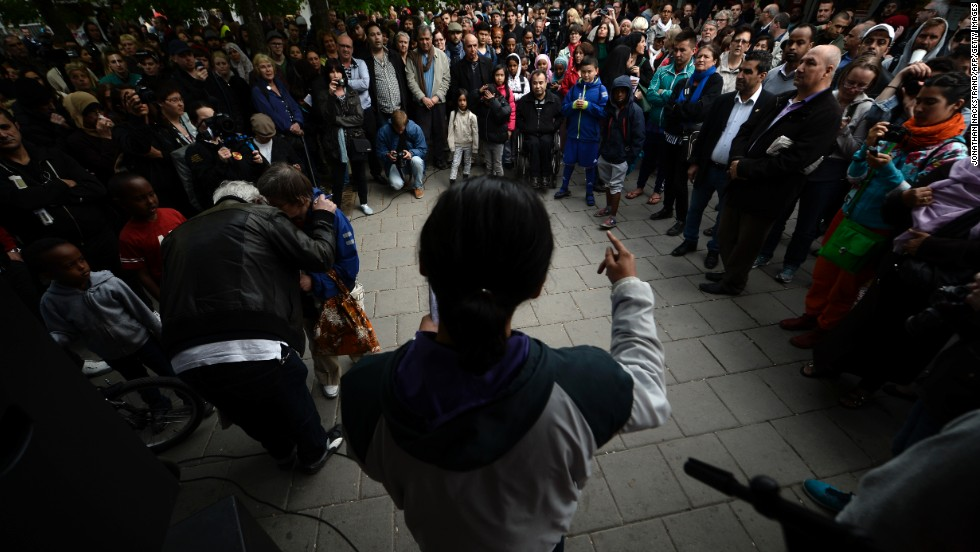 People attend a demonstration against police violence and vandalism in the Stockholm suburb of Husby on Wednesday, May 22.