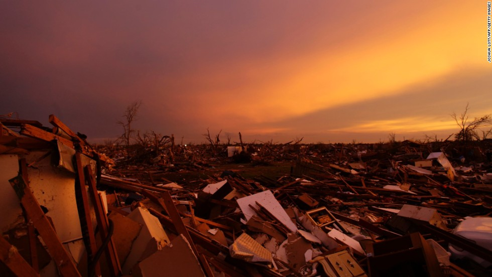 The sun sets over debris from houses littering the ground in Moore, Oklahoma, on Thursday, May 23, three days after the town was damaged by a tornado.