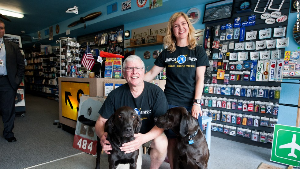 Pilots Richard Wells and Lora Yowell own a Bensenville, Illinois, gift shop called Aviation Universe, which has become the unofficial headquarters of ORD Airport Watch. The shop hosts the group's Picture Nights, where they share favorite photos. Wells and Yowell named their dogs Orville and Wilbur.