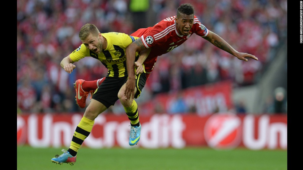 Borussia Dortmund's midfielder Jakub Blaszczykowski, left, vies with Bayern Munich's defender Jerome Boateng during the UEFA Champions League final at Wembley Stadium in London on Saturday, May 25.