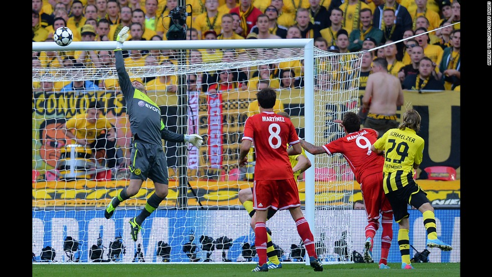 Dortmund's goalkeeper Roman Weidenfeller makes a save against Bayern during the first half.