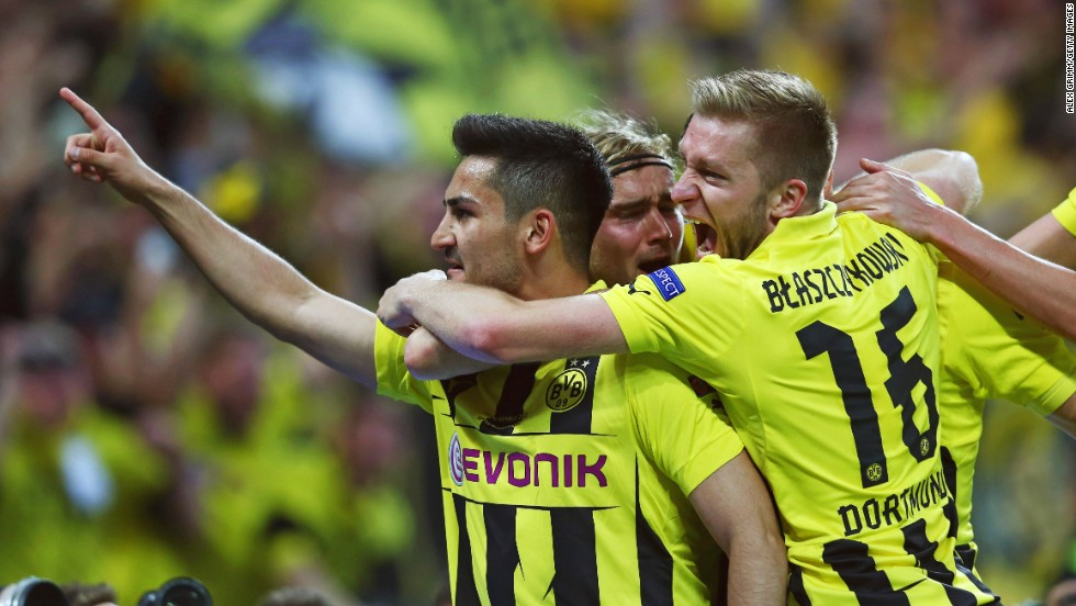 Ilkay Gundogan of Borussia Dortmund, left, celebrates with teammates after scoring on a penalty kick to tie the game 1-1.