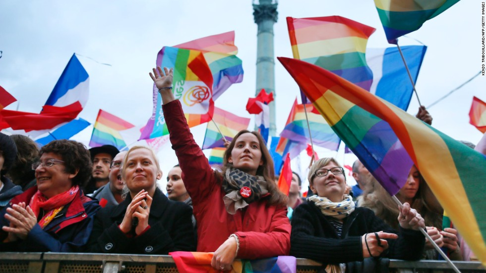 People holding rainbow flags attend the event Concert pour tous! (Concert for all!) on May 21 at Place de la Bastille square in Paris. The concert was a countermovement in reference to the French anti-gay marriage movement Manif pour tous (Demonstration for all), and celebrated the legalization of same-sex marriage.
