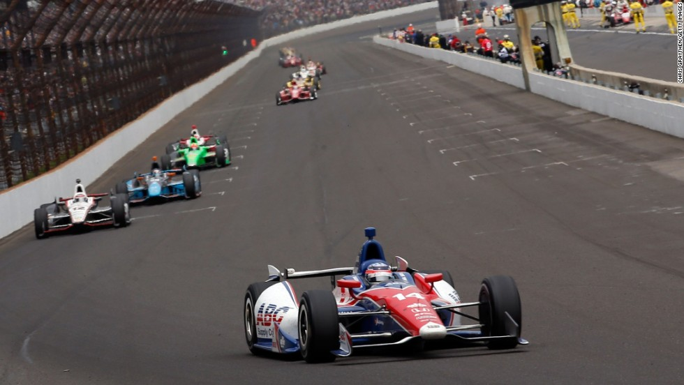 Takuma Sato of Japan, in car No. 14, holds the lead.