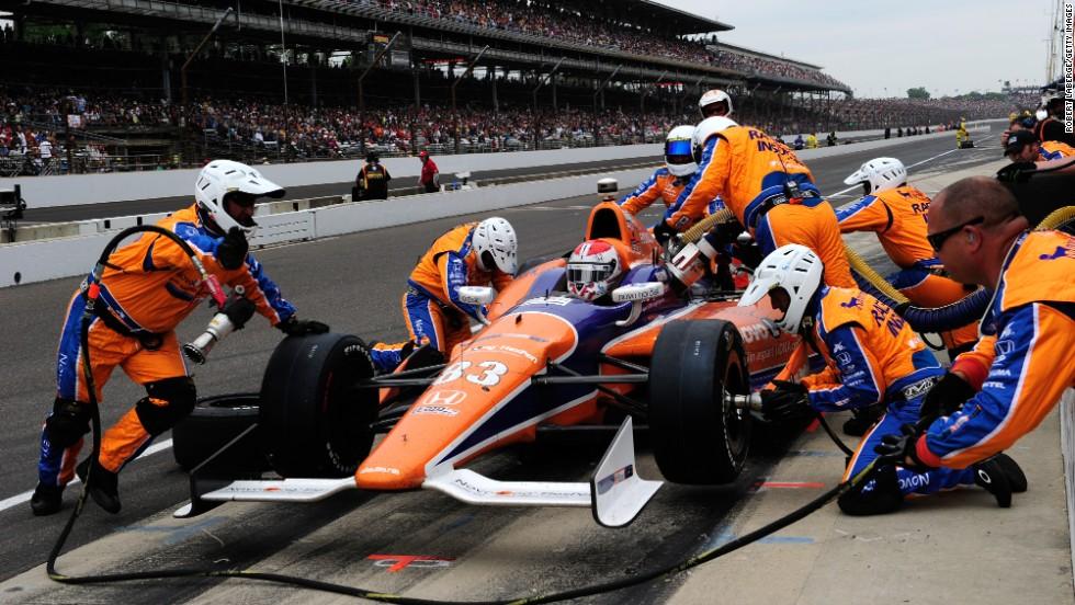 Charlie Kimball, driver of the No. 83 NovoLog FlexPen Honda, makes a pit stop.