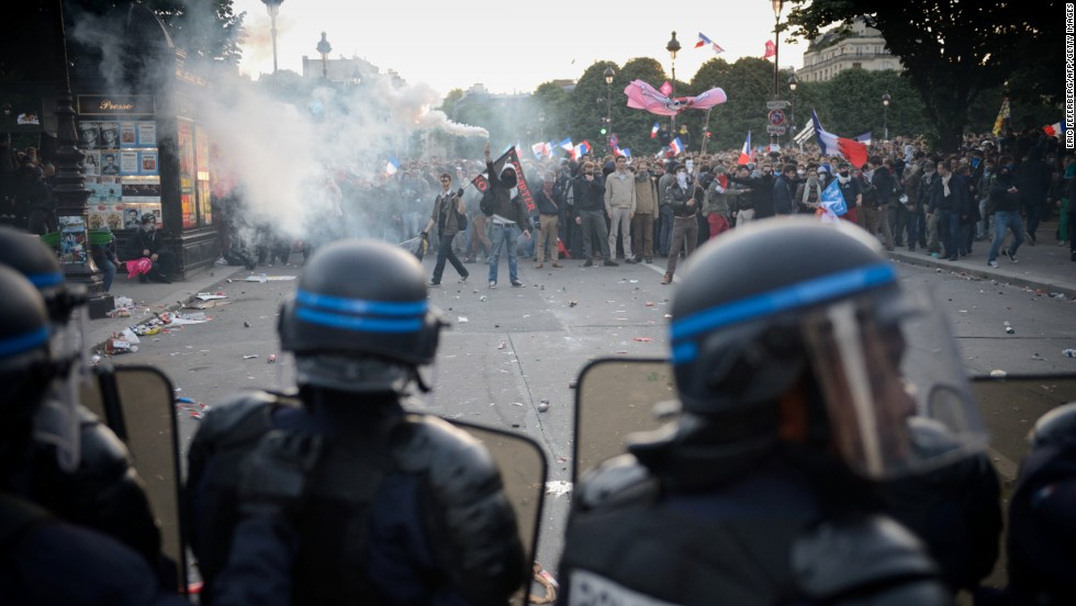 Riot policemen face off with protesters on May 26.