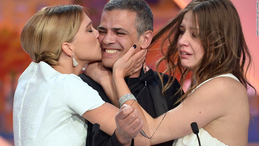 "French actress Lea Seydoux kisses French-Tunisian director Abdellatif Kechiche as actress Adele Exarchopoulos watches after he was awarded with the Palme d'Or for the film ""Blue is the Warmest Color"" during the closing ceremony of the 66th Cannes Film Festival in Cannes, France, on Sunday, May 26.  The Palme d'Or is the highest award given during the festival and is presented to the director of the winning film of the official competition."