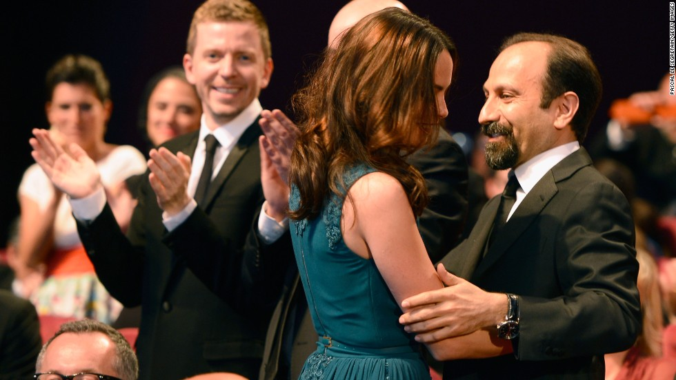 Actress Berenice Bejo hugs director Asghar Farhadi after winning the Prix d'Interpretation Feminine (best performance by an actress) for 'Le Passe' on May 26.