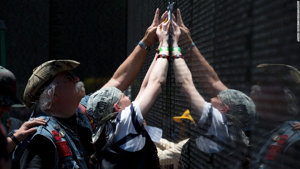 People make impressions of a name on the Vietnam Veterans Memorial in Washington on May 26.