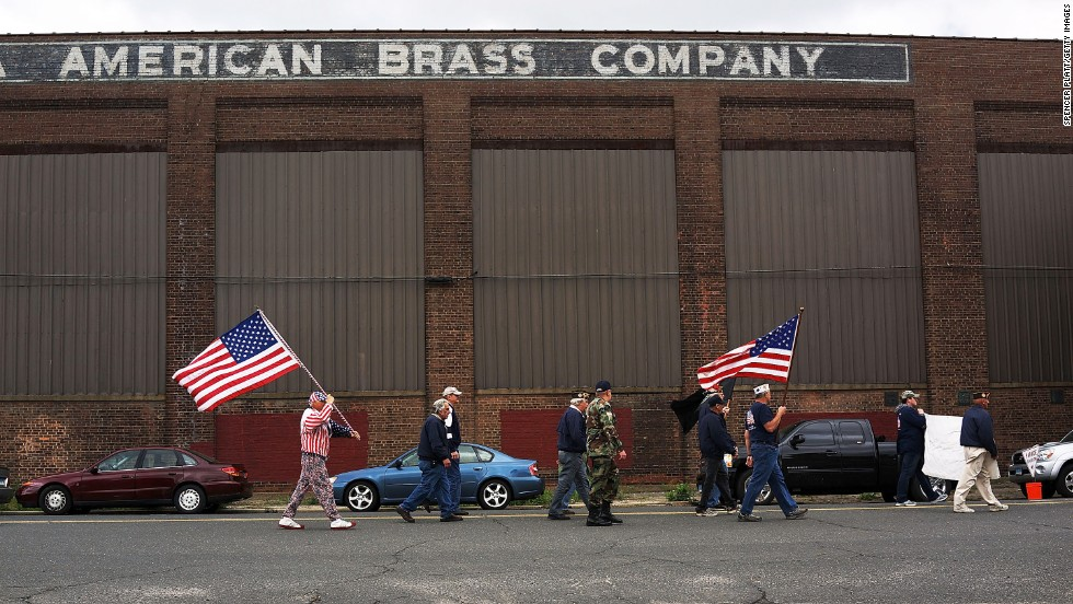 A group participates in a Memorial Day parade on May 26 in Waterbury, Connecticut.