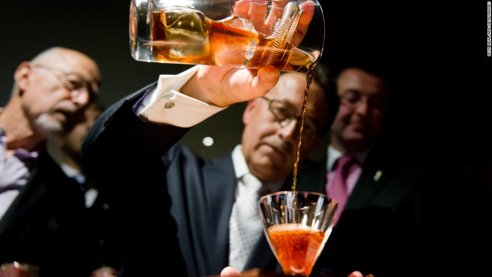 Bar owner Salvatore Calabrese pours a glass of 'Salvatore's Legacy', during an attempt to make the world's most expensive cocktail at  Salvatore's Playboy Club in London, England on October 11, 2012. The beverage is priced at 5,500 GBP (6,824 Euros) per glass and contains 40ml 1778 Clos de Griffier Vieux Cognac, 20ml 1770 Kummel Liqueur, 20ml circa 1860 Dubb Orange Curacao and two dashes of circa 1900s Angostura Bitters.