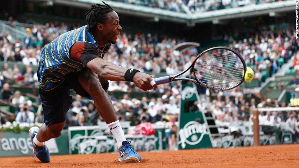 France's Gael Monfils stretches for a shot against Czech Republic's Tomas Berdych during the first round of the French Open on Monday, May 27, at the Roland Garros stadium in Paris. Monfils defeated Berdych 7-6(8), 6-4, 6-7(3), 6-7(4), 7-5.