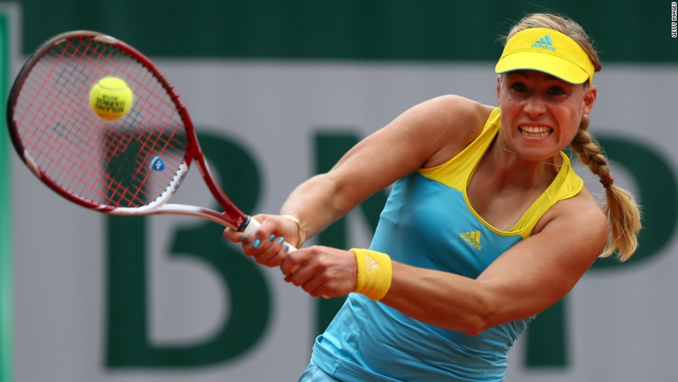 Angelique Kerber of Germany plays a backhand against Mona Barthel of Germany during day two of the French Open on May 27. Kerber won the match 7-6(6), 6-2.