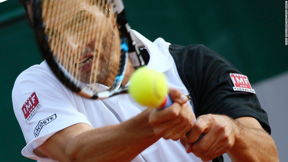 Spain's Albert Ramos returns the ball to Poland's Jerzy Janowicz on May 27. Janowicz defeated Ramos 7-6(3), 7-5, 6-3.